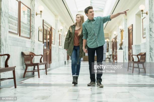 Caucasian couple walking in courthouse
