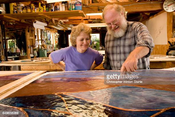 caucasian craftspeople in workshop - stained glass stock pictures, royalty-free photos & images