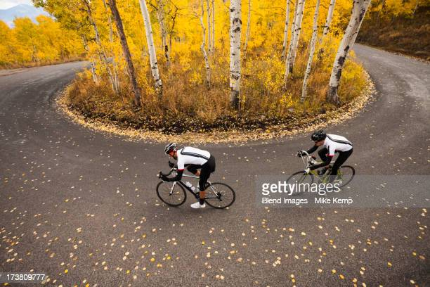 Caucasian cyclists on rural road
