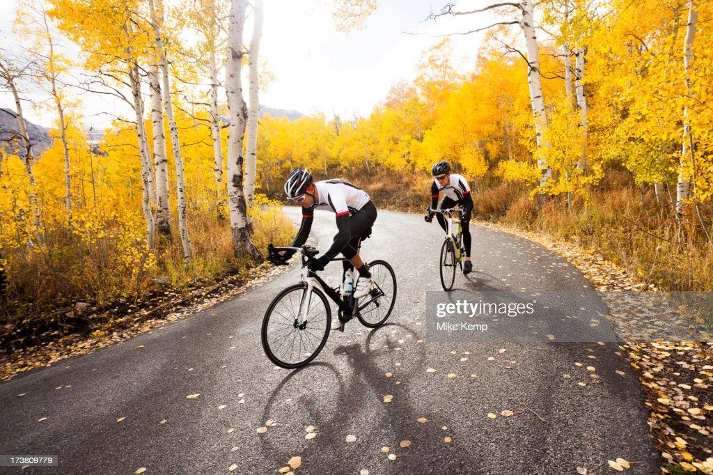Caucasian cyclists on rural road : ストックフォト