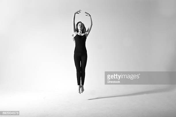 Caucasian dancer jumping for joy