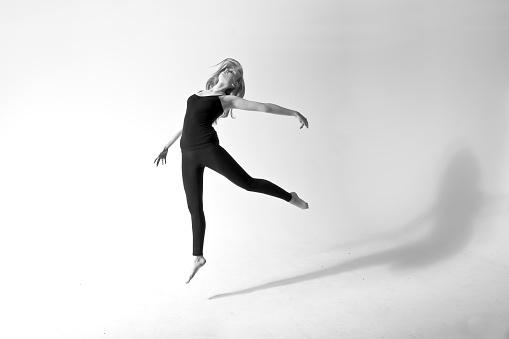 Caucasian dancer jumping for joy - gettyimageskorea