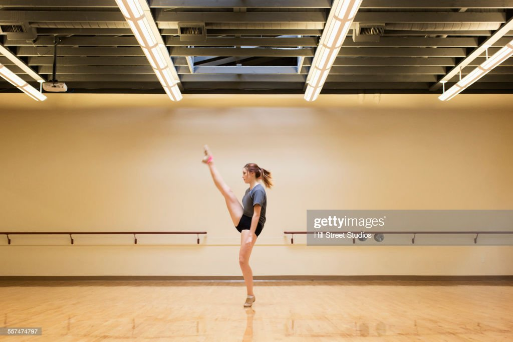 Caucasian dancer rehearsing in studio : Stock Photo