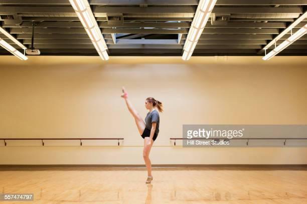 Caucasian dancer rehearsing in studio