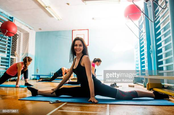 caucasian dancer stretching in gym - doing the splits stock photos and pictures