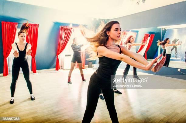 Caucasian dancers rehearsing in studio