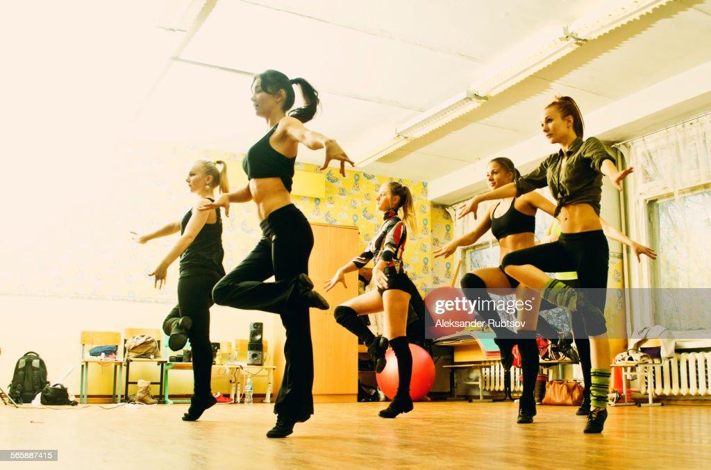 Caucasian dancers rehearsing in studio : Stock Photo
