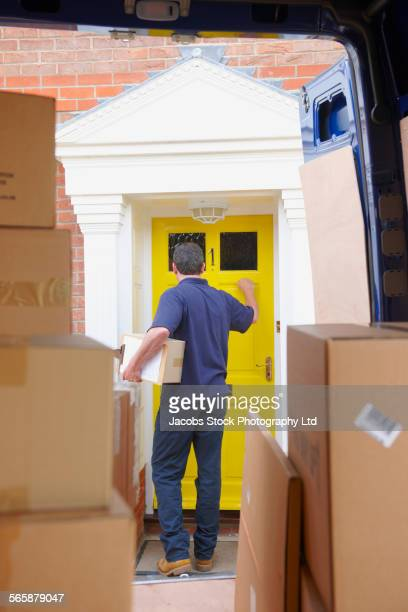Caucasian delivery man delivering package