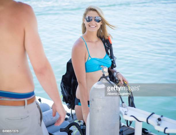 Caucasian divers smiling on boat