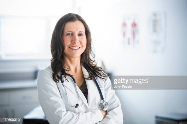 Caucasian doctor smiling in office
