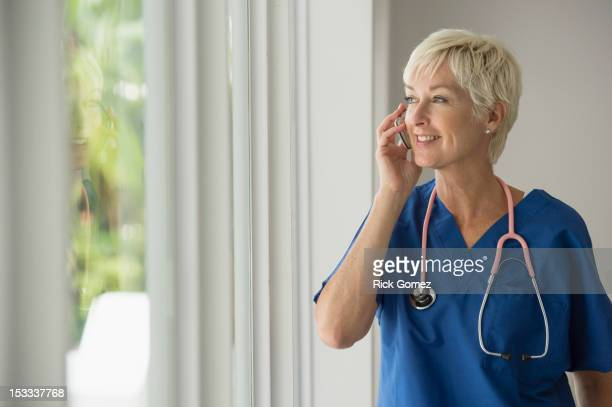 Caucasian doctor talking on cell phone