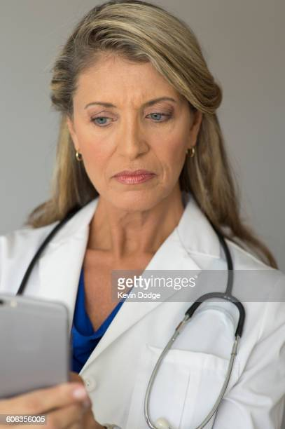 Caucasian doctor using cell phone