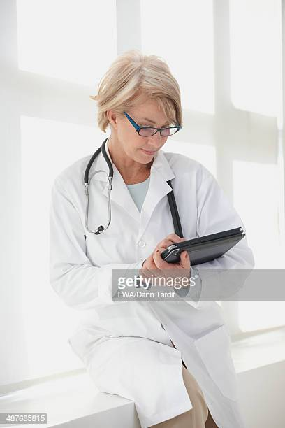 Caucasian doctor using digital tablet in hospital