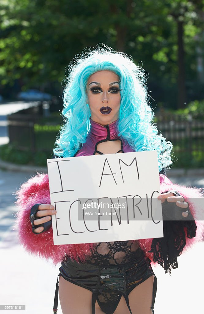 Caucasian drag queen holding empowering sign : Stock Photo