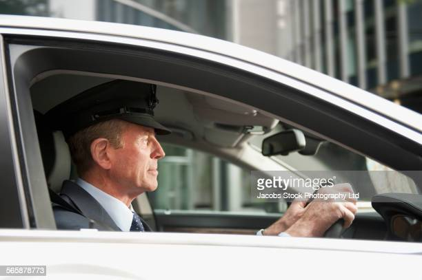 Caucasian driver driving car in city