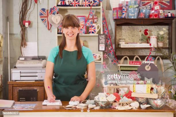 Caucasian employee smiling in gift shop