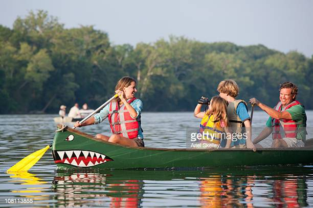 Caucasian family canoeing together