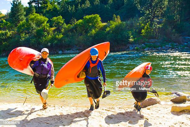 Caucasian family carrying kayaks