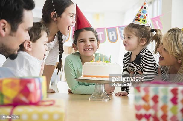 Caucasian family celebrating at birthday party