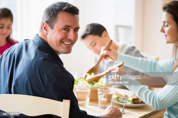 Caucasian family eating at table
