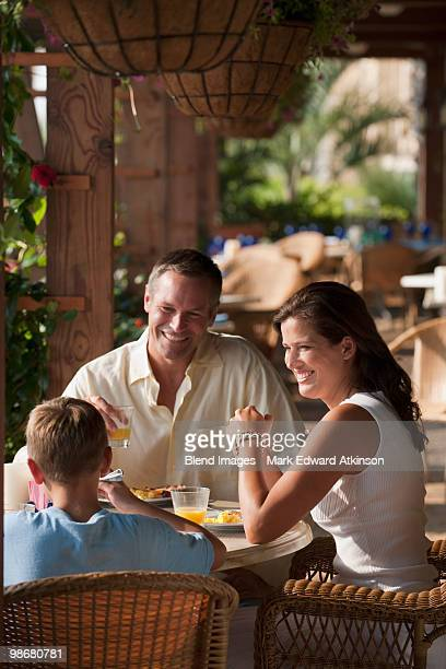 Caucasian family eating in restaurant