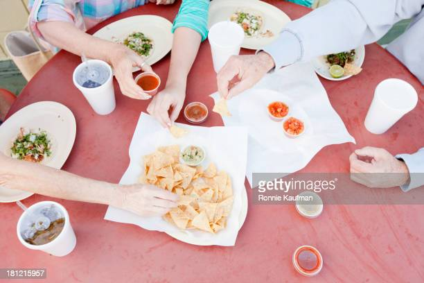 Caucasian family eating together