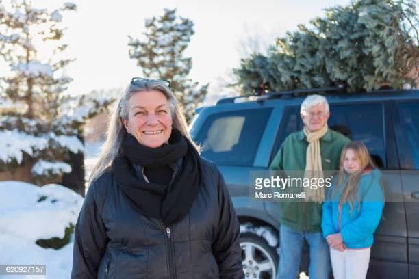 Caucasian family hauling Christmas tree
