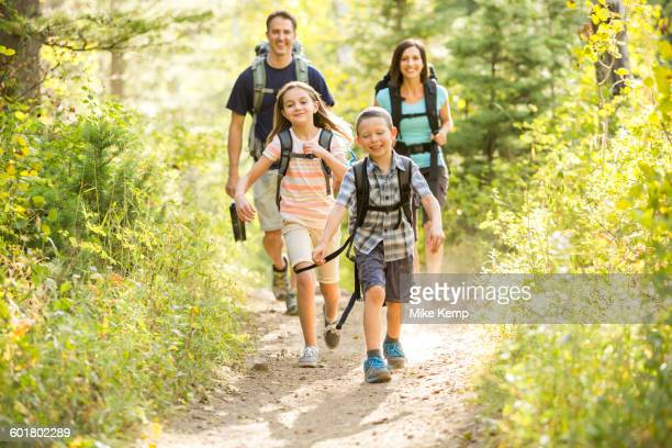Caucasian family hiking on path