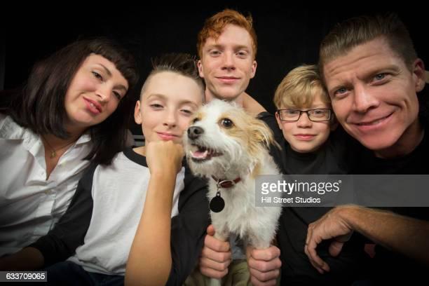 Caucasian family holding dog