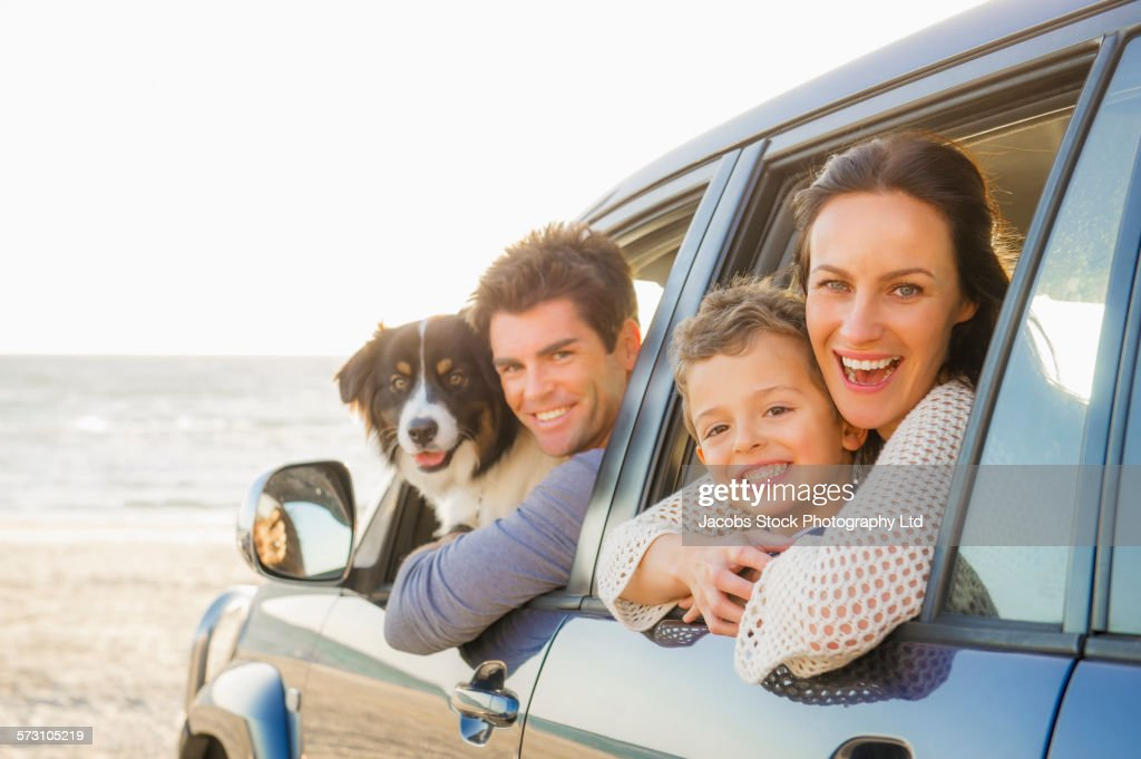 Caucasian family in car windows on beach : Foto stock