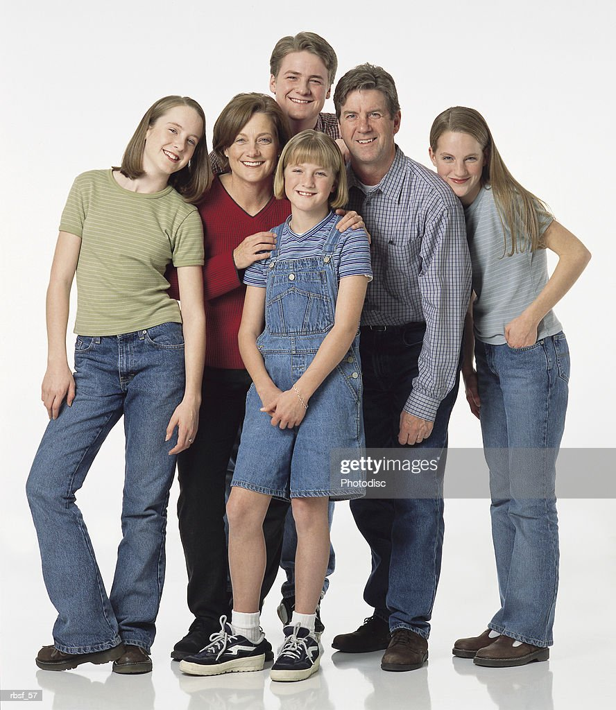 caucasian family of parents and four teenagers all stand together with smiles and personality : Foto de stock