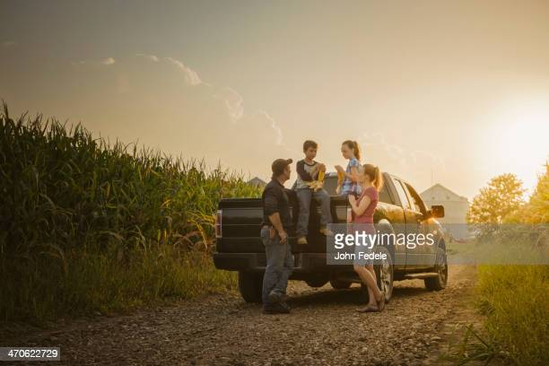 Caucasian family on truck on dirt road