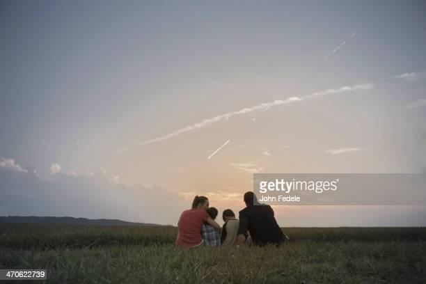 Caucasian family overlooking crop fields