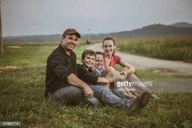 Caucasian family overlooking crop fields