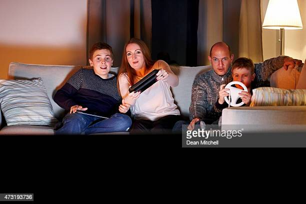 Caucasian family playing video game at home