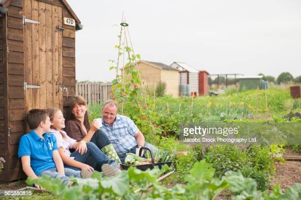 Caucasian family relaxing in farm field
