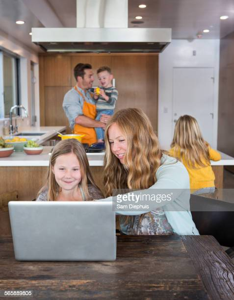 Caucasian family relaxing in kitchen