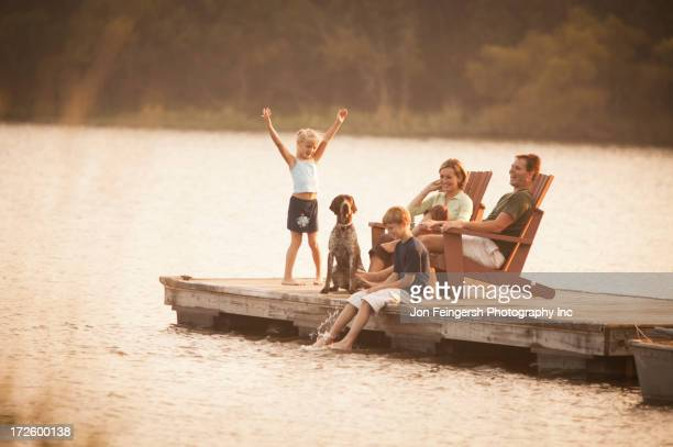 caucasian family relaxing on pier - mujeres fotos stock pictures, royalty-free photos & images