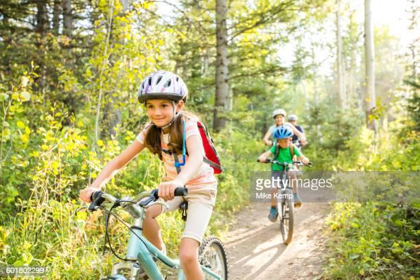 caucasian family riding mountain bikes - lane sisters stock photos and pictures