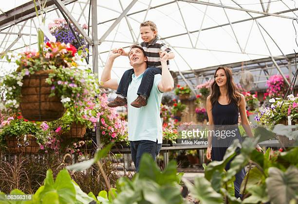 Caucasian family shopping in plant nursery