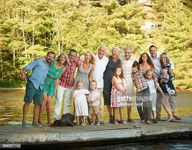 Caucasian family smiling on pier