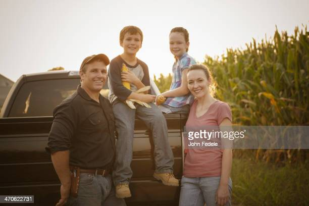 Caucasian family smiling on truck
