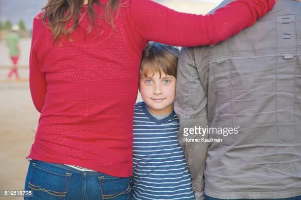 caucasian family standing outdoors - sezione centrale foto e immagini stock