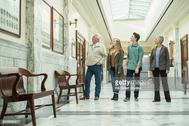 Caucasian family touring courthouse
