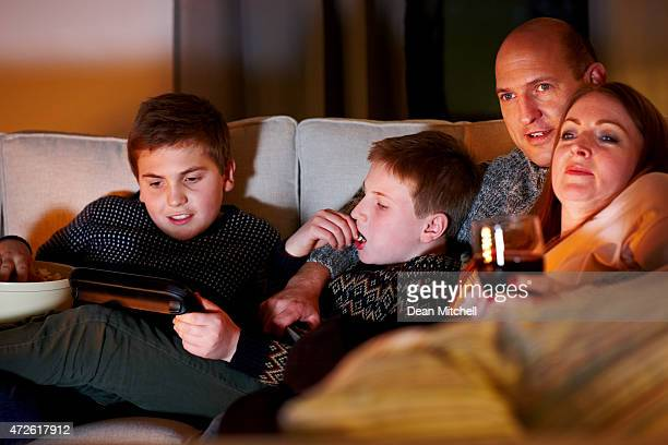 Caucasian family watching television