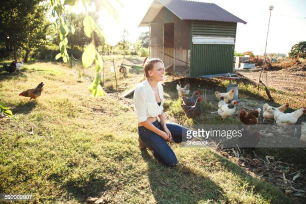 caucasian farmer crouching by hen house - chicken coop stock pictures, royalty-free photos & images