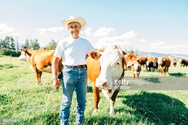 Caucasian farmer petting cow