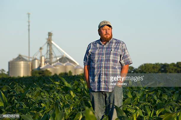Caucasian farmer standing in crop field