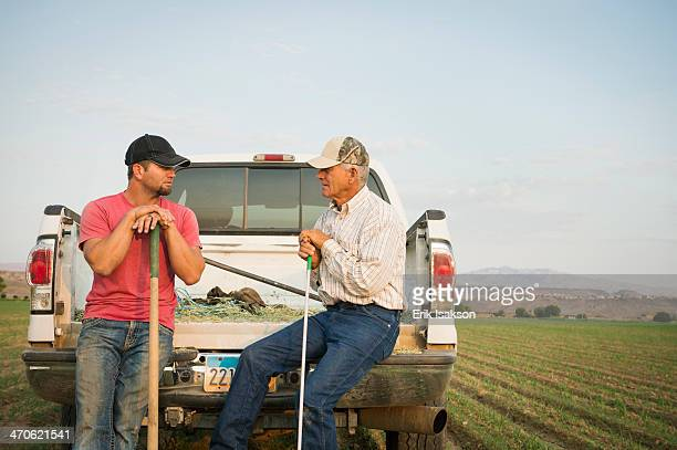 Caucasian farmers working in crop field