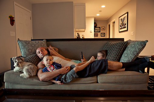 Caucasian father and children relaxing on sofa - gettyimageskorea